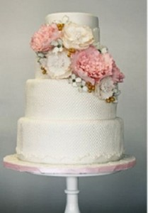 Pastel diagonal flower arrangement on wedding cake by Sweet and Saucy Cakes