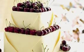 white chocolate envelope wedding cake with fresh cherries by Eric Lanlard of Cake Boy