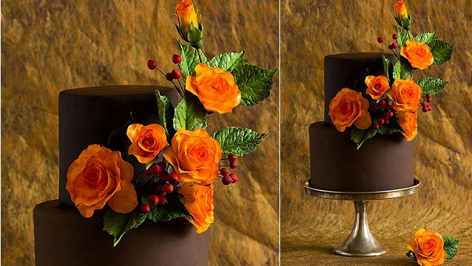chocolate wedding cake with Autumn floral arrangement orange roses and red berries by Bakministeriet