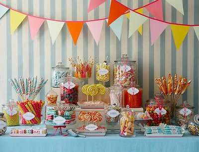 sweet table decor with bunting candyland theme via AMY ATLAS