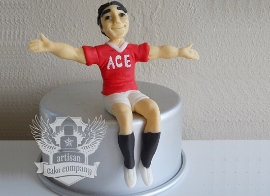 footballer cake topper soccer player sitting cake topper by The Artisan Cake Company
