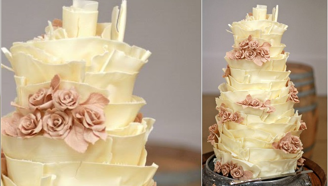 white chocolate ruffle wedding cake by Kanya Hunt with blush roses