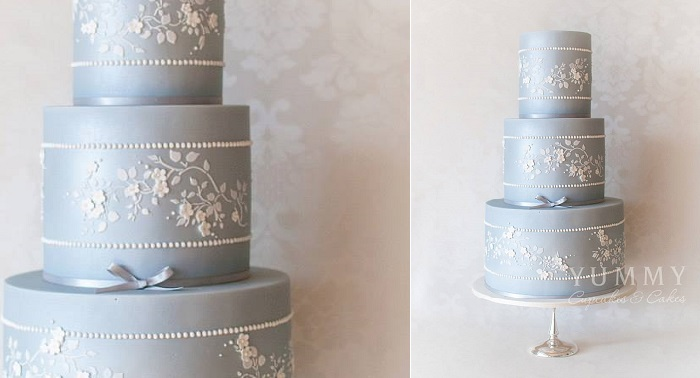 blue wedding cake with lace details by Yummy Cupcakes & Cakes