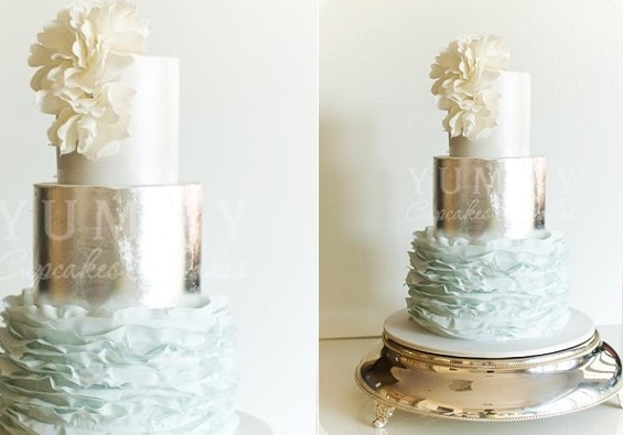 blue wedding cake with metallic silver and ruffles by Yummy Cupcakes & Cakes