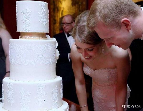 lace sash wedding cake via Evil Cake Genius, image by Studio 306