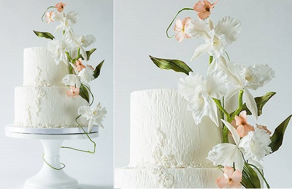 white woodgrain wedding cake with textured detailing and white irises by Lina Veber Cake