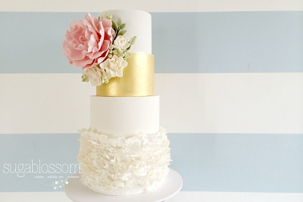 textured frills ruffle wedding cake with summer flowers by Sugablossom
