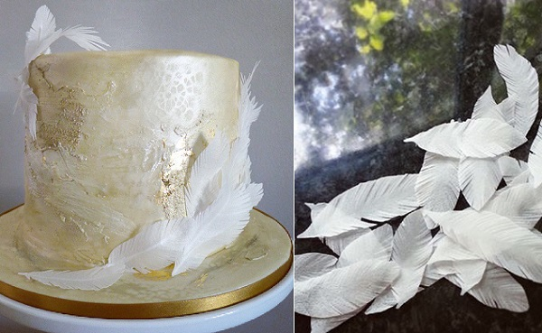 textured cake design with feathers in gold and white by Olofson Design