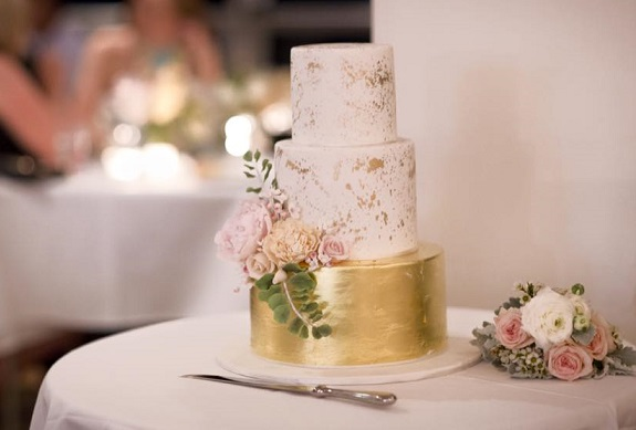 Distressed gold wedding cake with contemporary posy by The Cake That Ate Paris