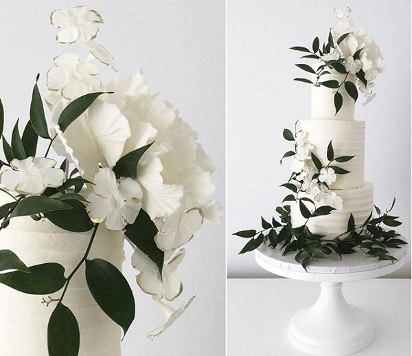 Green and white wedding cake with gumpaste greenery and gold tipped blossoms by Jenna Rae Cakes