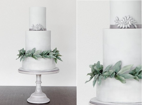 Watercolor gray wedding cake with berried foliage and silver brooch by Pasteles Alma