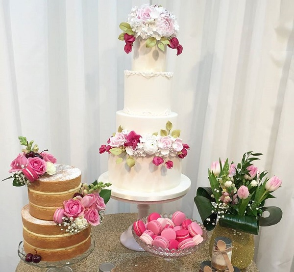 Bas relief trimmed wedding cake with gumpaste garden roses by The Designer Cake Co.