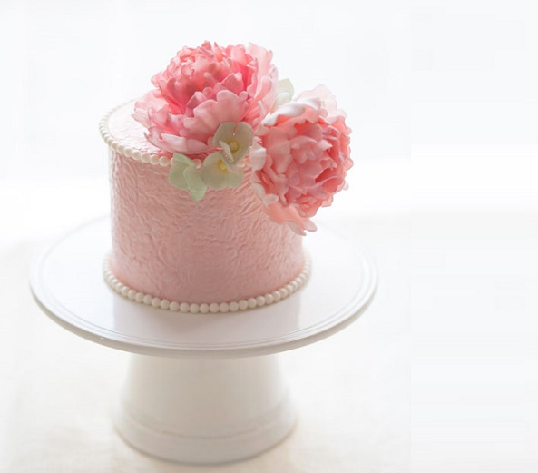 Pearl trimmed cake with gumpate peonies by La Cupella Cakes