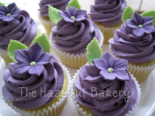 Purple floral cupcakes by The Hazelnut Bakery