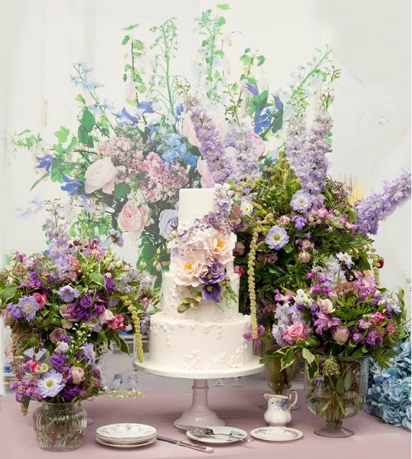 Purple floral wedding cake with bas relif decoration by Cakes by Krishanthi