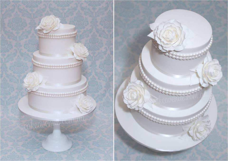 Elegant pearl bands on white wedding cake with roses by Cake Avenue, Sydney