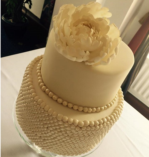 Pearl encrusted cake tier with peony topper by the Meadow Cottage Bakery