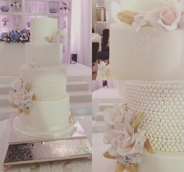 Pearl encrusted wedding cake with pink roses and lilac blooms by Cakes by Krishanthi