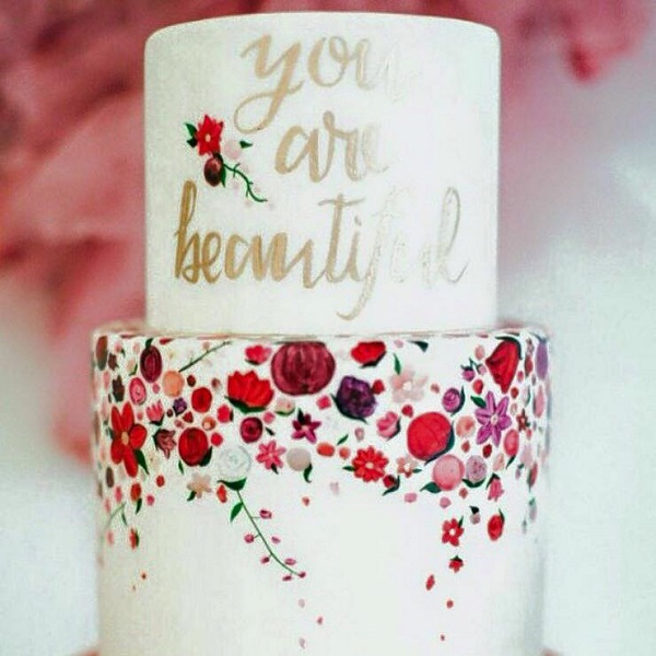 Gold handpainted cake calligraphy by Sweet and Saucy