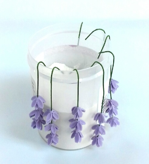 Easy gumpaste lavender tutorial on Cake-Geek.com, with additional petal sets attached to the wire