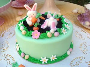a cake for a gardener with bunny rabbits stealing carrots by Butter Hearts Sugar