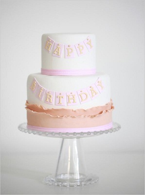happy birthday banner cake by Erica O'Brien in pink, peach and white pastel colours