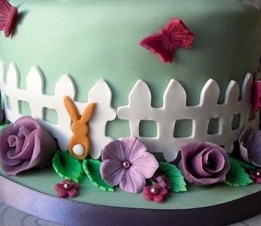 rabbit in garden with picket fence birthday cake