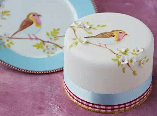 multi dimensional cake decorating  hand painted robin and sugar blossoms via Lover.ly