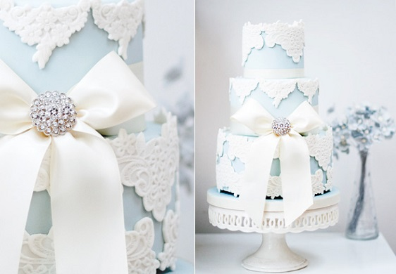 blue wedding cake with lace applique and brooch by Rosalind Miller