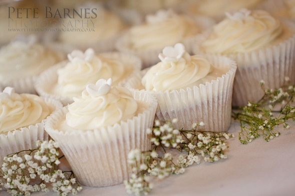 cupcakes with Baby's Breath sprays by Pete Barnes Photography via English Wedding