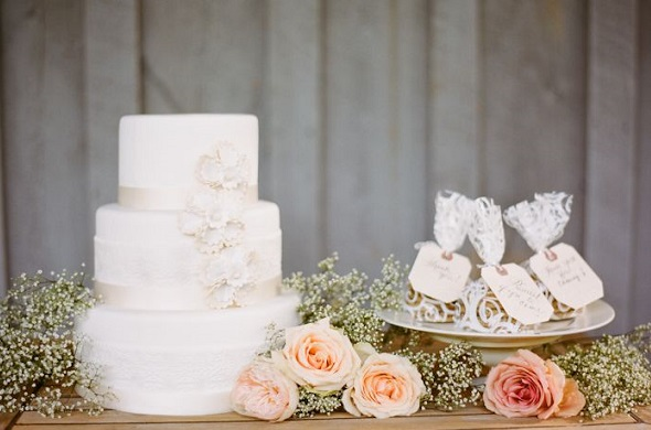 wedding cake table decorated with baby's breath, image by Nathan Westerfield Photography