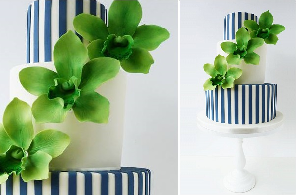 navy and white wedding cake striped with green orchids by Suzanne Esper Cakes