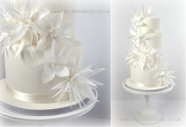 8. winter wedding cake with wafer paper flowers by Fat Cakes Design UK