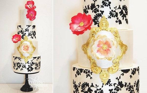 gilded gold framing and damask pattern wedding cake by Cakes 2 Cupcakes