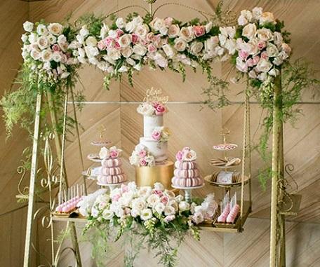 garden swing wedding cake by Cupcakes by Rita