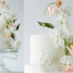 white woodgrain wedding cake with textured detailing and white irises by Lina Veber Cake