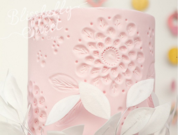 embossed flower cake design pastel pink by Blissfully Sweet Cakes