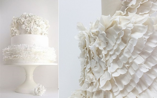 textured frills and flowers wedding cake left by Maggie Austin, right by Jenna Rae Cakes