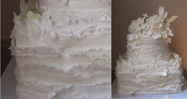 white ruffle wedding cake with frills and flowers by Megan Joy Cakes