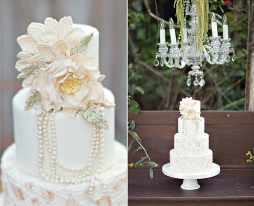 wildlife inspired vintage wedding cake with rustic feathers and draped pearls, image via Pinterest (uncredited)