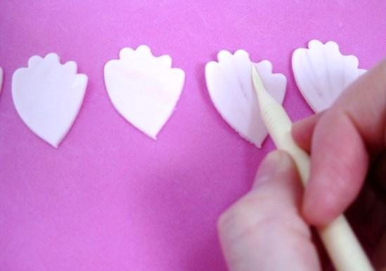 veining gumpaste peony petals with Dresden tool
