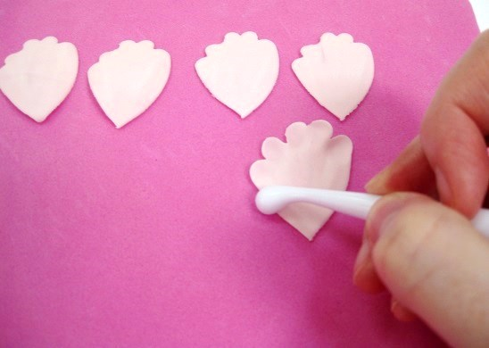softening the edges of gumpaste peony petals with bone tool