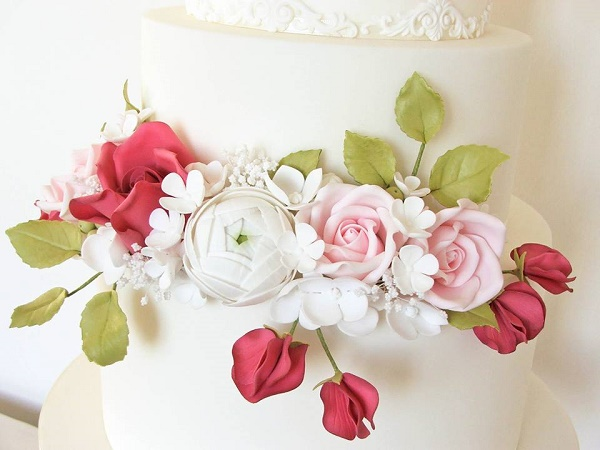 Sweet Pea wedding cake with mixed flowers by The Designer Cake Co.
