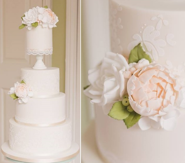 Ivory and peach wedding cake with stencilled lace detailing and lace trim by The Designer Cake Co