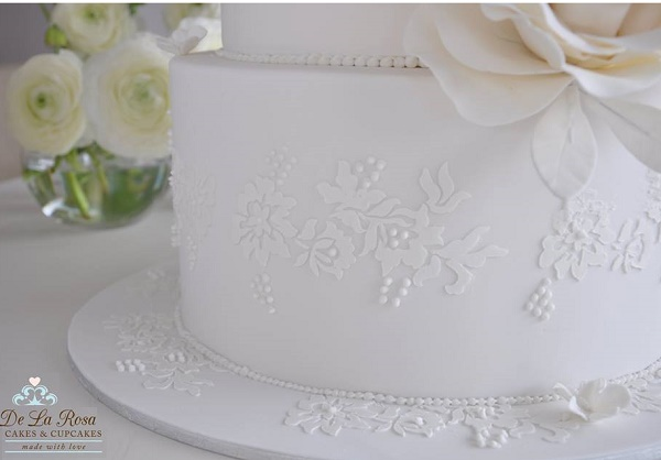 Stencilled lace wedding cake with piped pearls by De La Rosa Cakes & Cupcakes