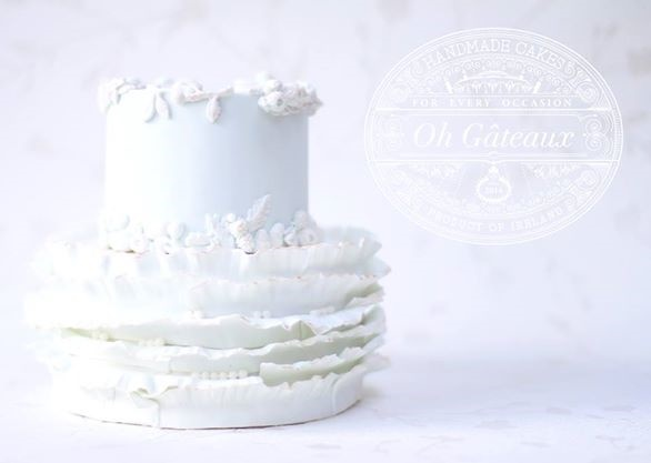 Wedding cake with bas relief borders by Oh Gateaux
