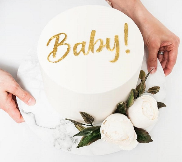 Baby shower cake with custom gold calligraphy by Cake Ink