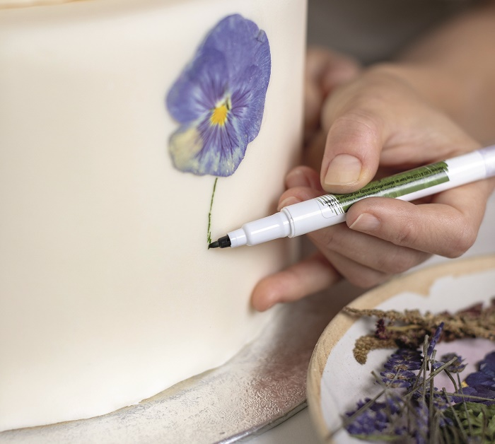 Wildflower Wedding Cake Tutorial, drawing in the stems with an edible ink pen