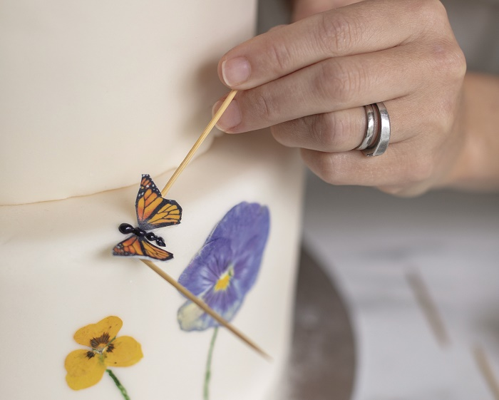 Wildflower Wedding Cake Tutorial, supporting the wings with cocktail sticks