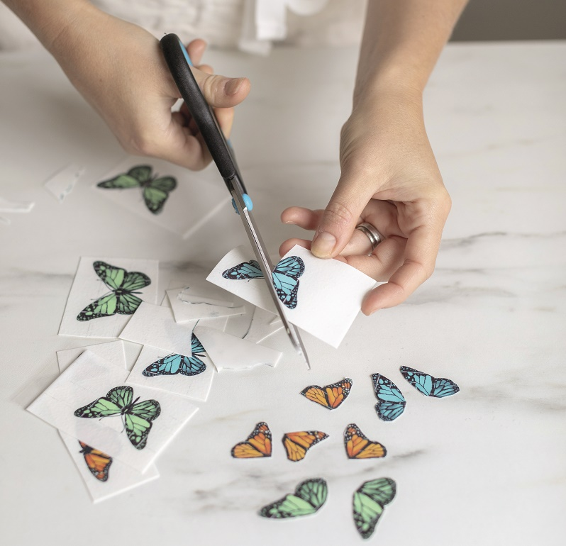 Wildflower wedding cake tutorial, cutting out the edible printed butterflies